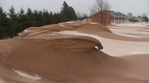 Red snow on Prince Edward Island due to wind erosion