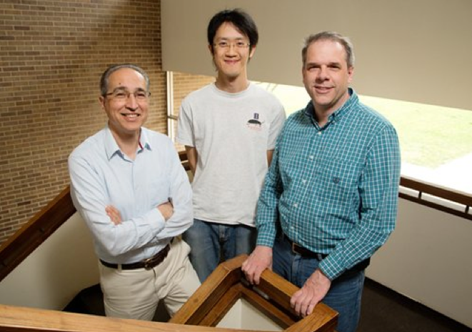 University of Illinois entomology senior scientist Manfredo Seufferheld, left; Illinois Natural History Survey insect behaviorist Joseph Spencer, right; graduate student Chia-Ching Chu and their colleagues found that gut microbes helped the Western corn rootworm beetle survive in soybean fields long enough to lay its eggs.