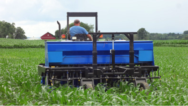 The new InterSeeder™ from InterSeeder Technologies of Woodward, Pa., simultaneously plants three rows of cover crops while spraying post-emergent herbicide and nitrogen fertilizer in single passes between four or six rows of knee-high corn.  InterSeeder Technologies markets the machine under a license agreement with Penn State University.